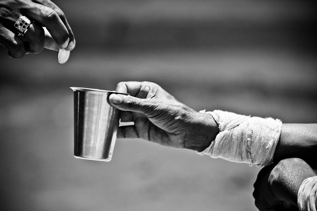Government benefit programs cut poverty in a half